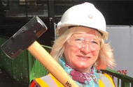 Demolition of the Broadmarsh car park and bus station is officially underway after a 62-year-old retired nursery teacher swung the first sledgehammer.